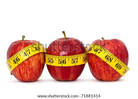three apples with measure tape on white background