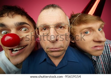 Three april fools looking at camera with different expressions - stock photo