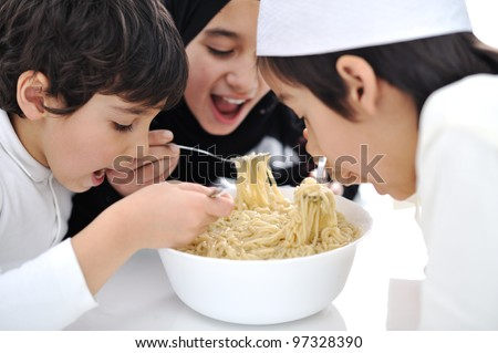 Three Arabic children eating together - stock photo