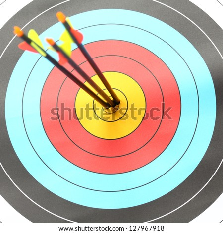 Three Arrow hit goal ring in archery target - stock photo