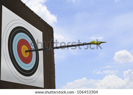 Three arrows hit an archery target. - stock photo