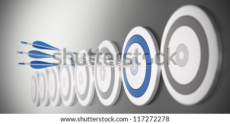three arrows hitting the center of a blue target, there is many targets in a row with blur effect - stock photo
