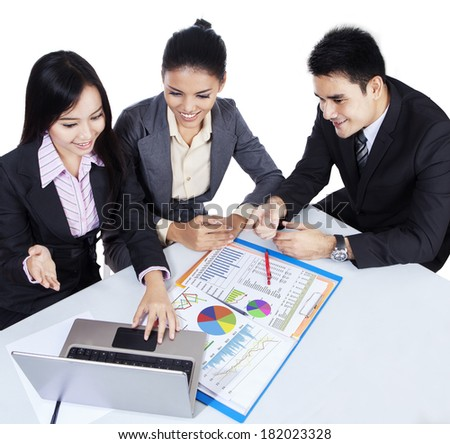 Three asian business team working with laptop. isolated on white background - stock photo