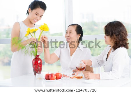 Three asian women seated at table