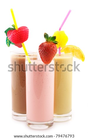 Three assorted protein cocktails with straws and decorations isolated on white background.