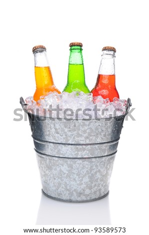 Three assorted soda bottles in a bucket filled with ice. Vertical Format over a white background with reflection