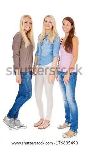 Three attractive girls standing next to each other.  - stock photo