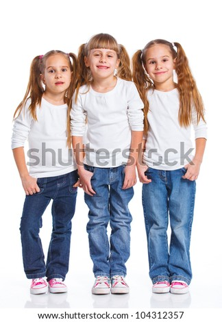 Three attractive sisters. Triplets. Isolated on white.