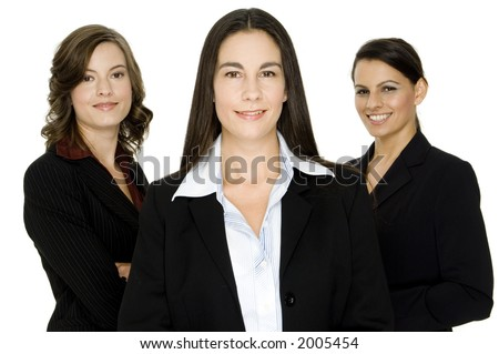Three attractive well-dressed businesswomen on white background