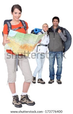 Three backpackers - stock photo
