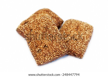 Three baked biscuits on white background - stock photo