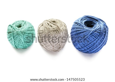 Three balls of cotton yarn isolated on white background