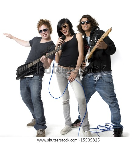 Three band mates sing and play guitar - stock photo