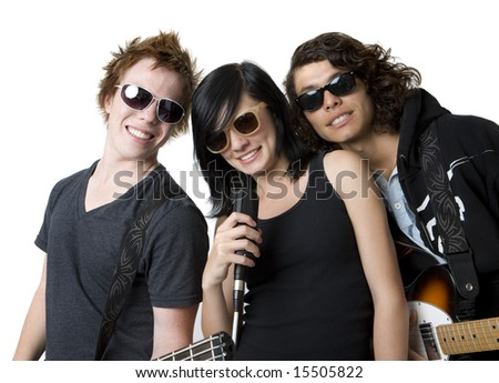 Three band mates with instruments in a studio - stock photo