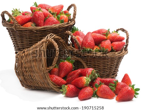 three baskets with strawberry isolated  on a white