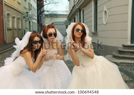 three beautiful brides having fun - stock photo