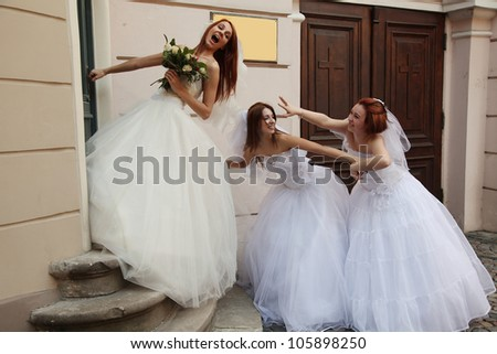 three beautiful brides having fun