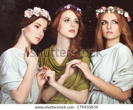 Three beautiful girls  in wreath.  Photo in old color image style. - stock photo