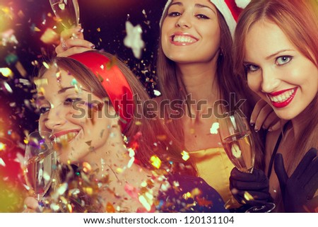 Three beautiful girls on the New Year's Eve - stock photo