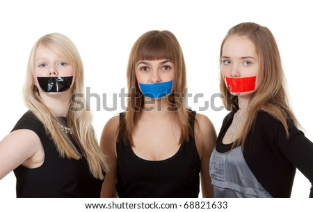 Three beautiful girls with their mouths taped with tape