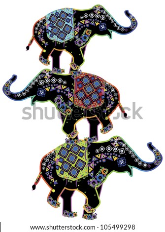 Three beautiful Indian elephants perform circus stunt in ethnic style - stock photo
