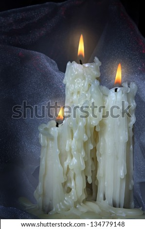 three beautiful old candles. - stock photo