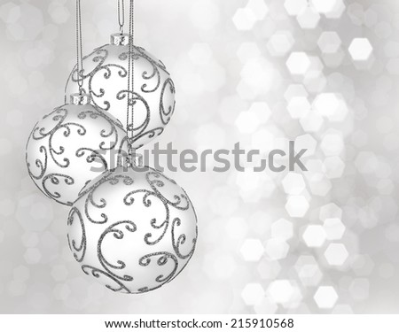 Three beautiful silver christmas balls on a silver background - stock photo