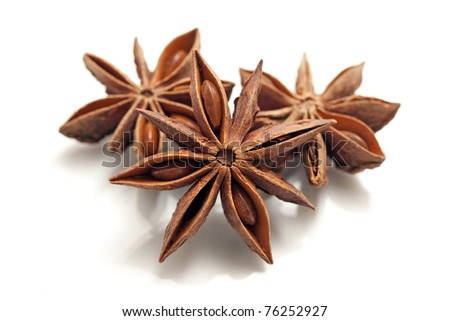 three beautiful star anise isolated on white
