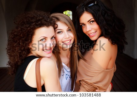 three beautiful women smiling