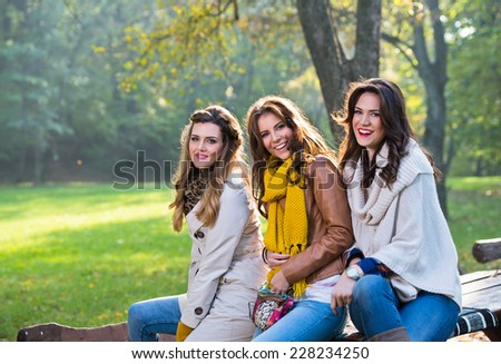 Three beautiful young women in the park - stock photo