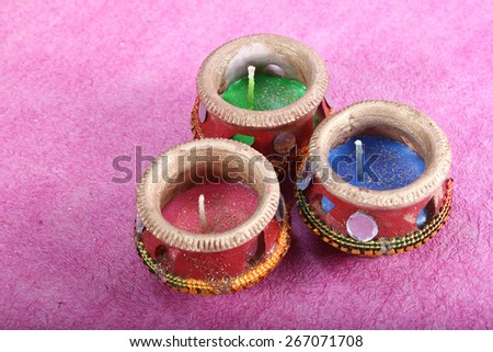 three beautifully decorated candle pot - stock photo