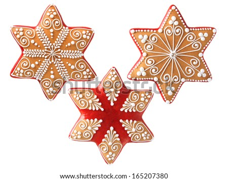 Three beautifully decorated Christmas cookies.  - stock photo