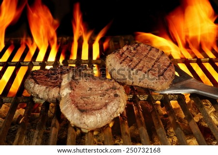 Three Beefsteaks on Hot the Flaming BBQ Grill - stock photo