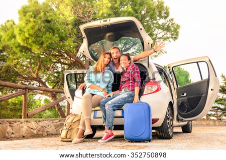 Three best friends travelers put hands sitting in the car. Young relaxing hipster wanderers enjoying exclusive alternative destination. Tourist with luggage are ready for holiday life moment.  - stock photo