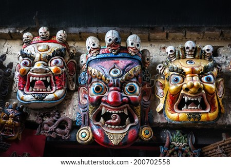 Three Bhairab masks on the wall in the shop in Bhaktapur, Kathmandu valley, Nepal    - stock photo