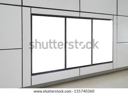 Three big blank billboard on white wall - stock photo