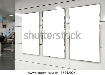 Three big vertical / portrait orientation blank billboard in public transport - stock photo