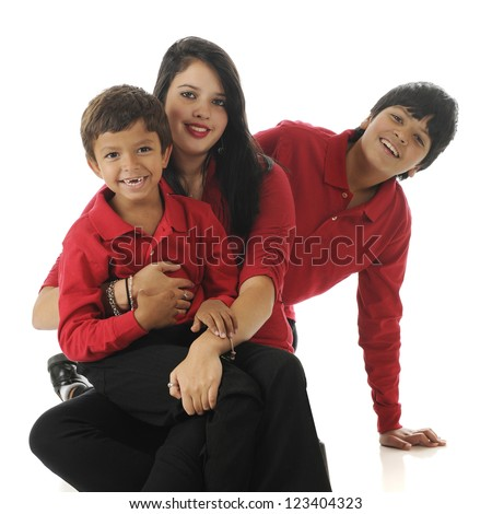 Three biracial siblings (Asian Indian & caucasian) on the floor ...a preschool boy, teenage girl and their preteen brother.  On a white background.