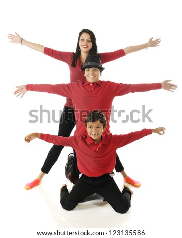 "Three biracial siblings stacked behind each other with their arms outstretched, like a 3-headed bug with 6 ""legs."""