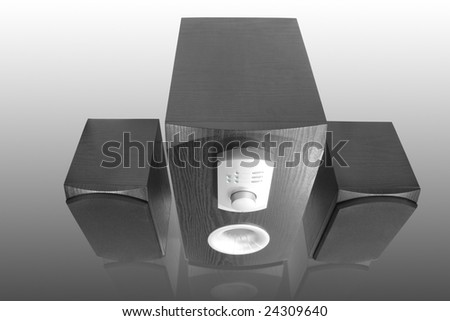 three black computer speakers with built in amplifier with reflection - stock photo