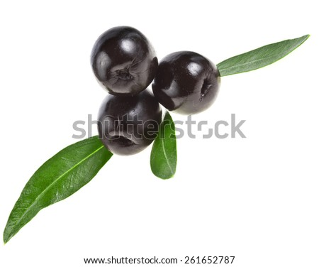 Three black olives  with leaves on a white background