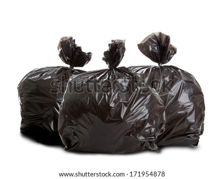Three black rubbish bags on white background - stock photo