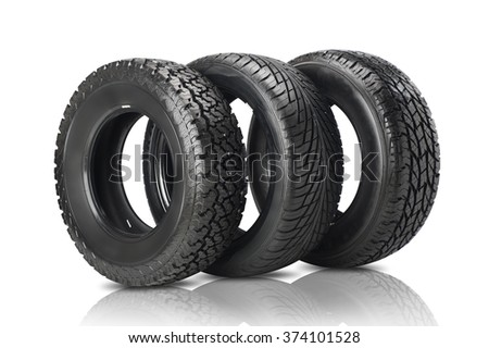 Three black tires isolated on white background - stock photo