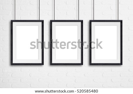 three black wooden frames hanging on cords against bricks wall mock up - Wooden Picture Frames