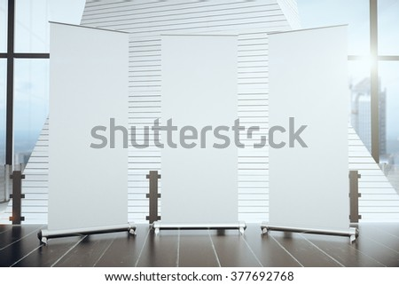 Three blank banners in a modern interior, mock up - stock photo