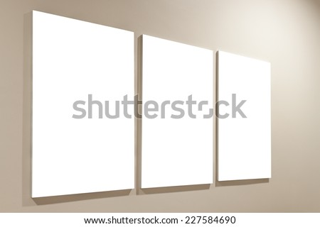 three blank frame on wall - stock photo