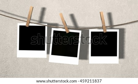 three blank instant photos hanging on the clothesline  - 3d rendering