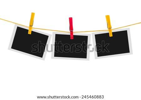 Three blank instant photos on clothesline isolated on white background with clipping path