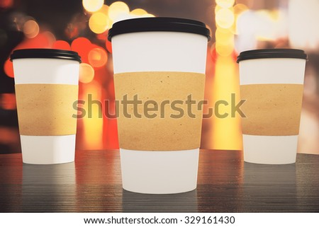 three blank paper coffee cup on a table in a cafe, mock up - stock photo