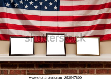 Three blank photo frames on a shelf with american flag background - stock photo